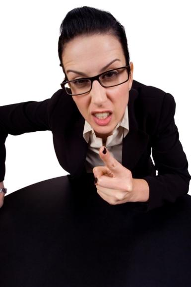 female holding up finger arguing wearing glasses