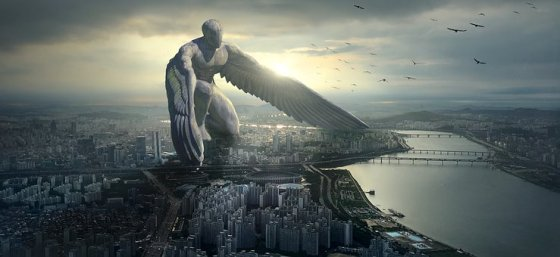 stone angel kneeling above a city