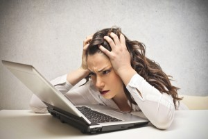 website-migration-failed-frustrated-woman-at-laptop-300x200